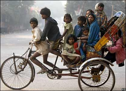 Overpopulation in India 10 people on a tricycle